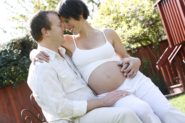 pregnant couple outdoor photo